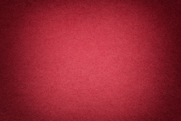 Texture of old bright red paper background, closeup. structure of dense cardboard. Premium Photo