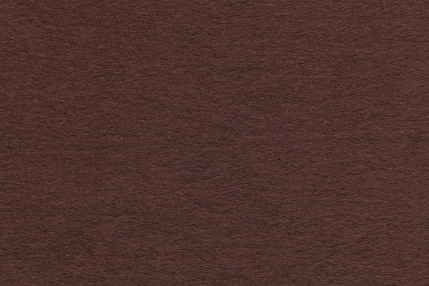 Texture of old brown paper closeup. structure of a dense cardboard. the background. Premium Photo