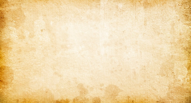Texture of old faded vintage paper, beige retro background,grunge paper with spots and streaks Premium Photo