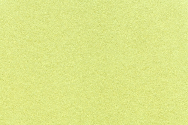 Texture of old light green paper background, closeup. structure of dense olive cardboard Premium Photo