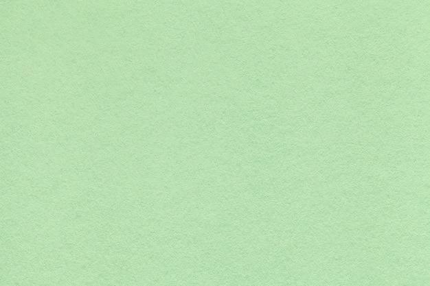 Texture of old light green paper closeup Premium Photo