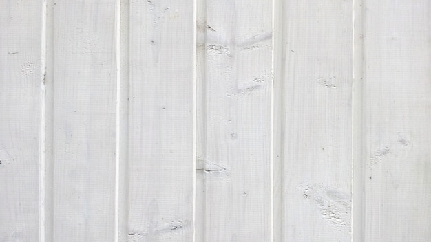 Texture of old wood planks with peeling white paint Premium Photo