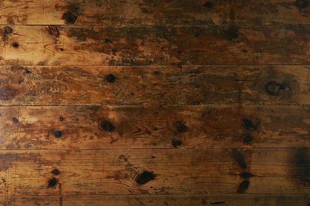 Texture di un vecchio tavolo o pavimento marrone scuro usurato, immagine ravvicinata Foto Gratuite