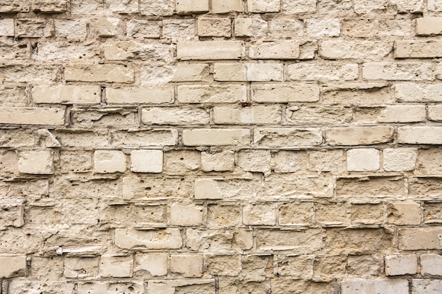 Texture of the old yellow brick. horizontal. space for text Premium Photo