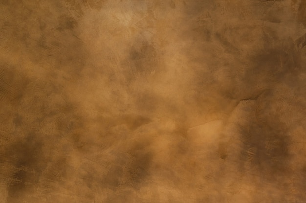 Texture of a orange brown concrete as a background, brown grungy wall Premium Photo