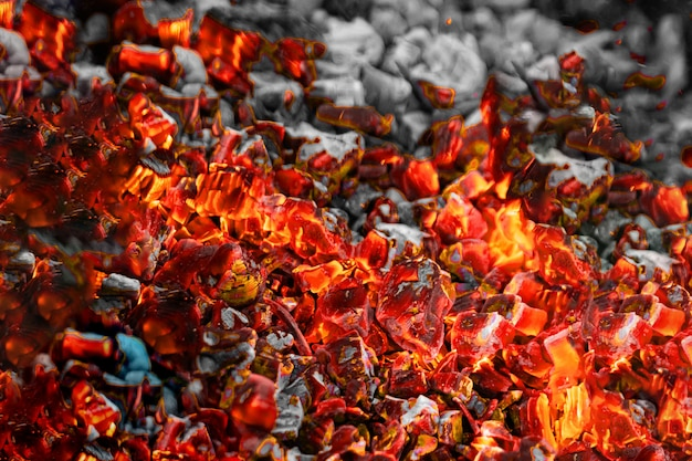 Texture red hot coals, selective focus. barbecue grill dark background Premium Photo