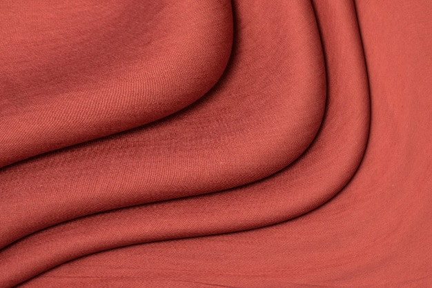 The texture of red linen fabric of dark red color close-up. textured abstract red background, top view Premium Photo