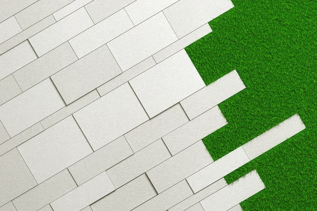 Texture of slabs of different sizes of rough concrete laid at an angle on a green lawn. Premium Photo