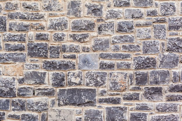 Texture of a stone wall. old castle stone wall texture background. Premium Photo