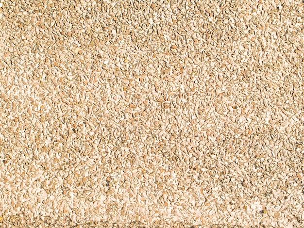 テクスチャは砂の背景を洗浄しました。テクスチャ:小石石のテクスチャ。砂浜のテクスチャ背景。壁の装飾自然コンセプトデザイン Premium写真