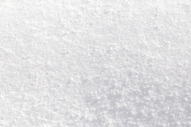 Texture of white snow sparkling in the sun. Premium Photo