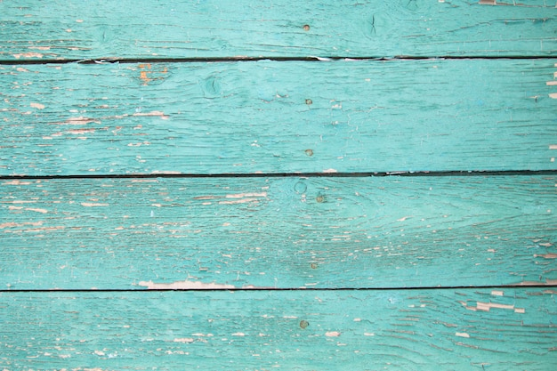 Texture wooden background with old cracked green paint Premium Photo