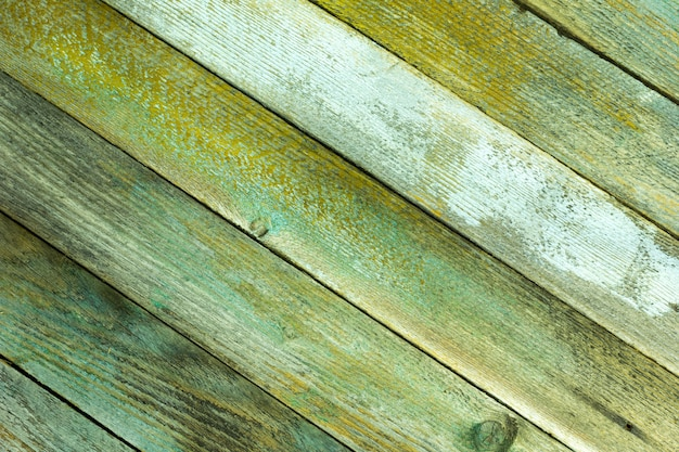 Textured background from old painted boards placed diagonally, grunge style. copyspace Premium Photo