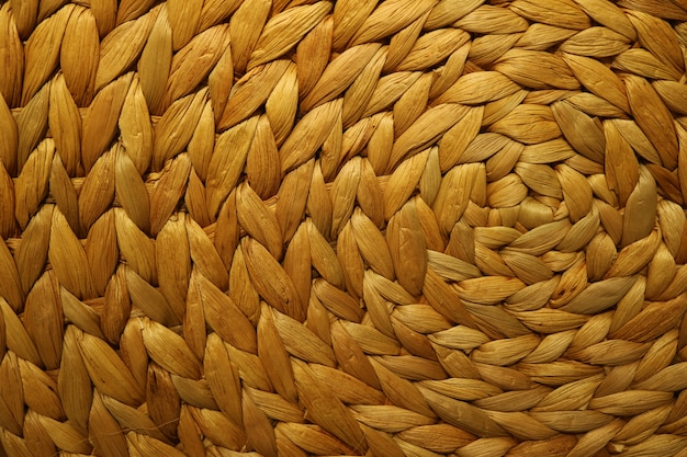 Textured background of a golden brown color woven water