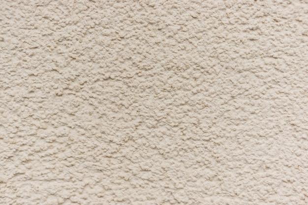 テクスチャードベージュの壁の背景 無料写真