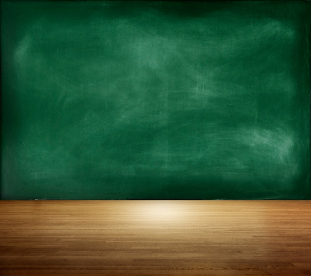 Textured blackboard on an empty room Free Photo