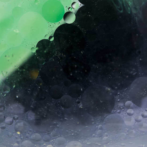 Textured green and black liquefy abstract background Free Photo
