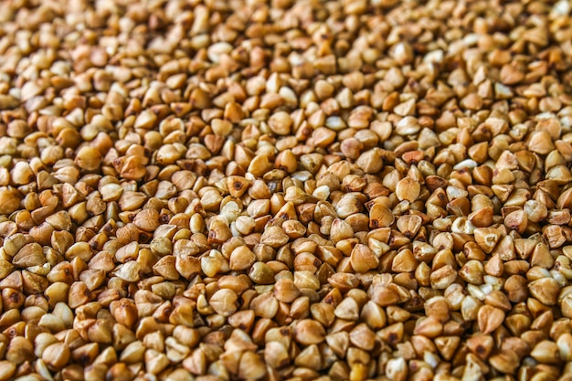 Textures from raw buckwheat grains. healthy food. top view Premium Photo