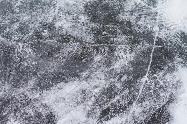 Texutured ise surface of frozen lake with cracks. Premium Photo