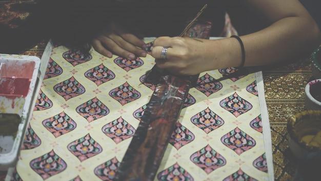 Thai artist drawing thai art for making thai silk Premium Photo