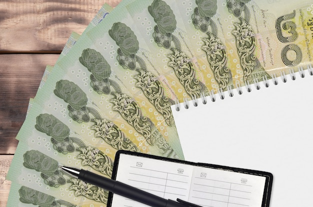 Thai baht bills fan and notepad with contact book Premium Photo