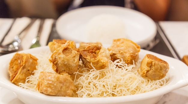 Thai chinese traditional food: deep fried crab meat rolls in tofu sheets Premium Photo