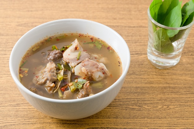 Thai clear spicy hot and sour soup of beef entrails served with sweet basils. Premium Photo