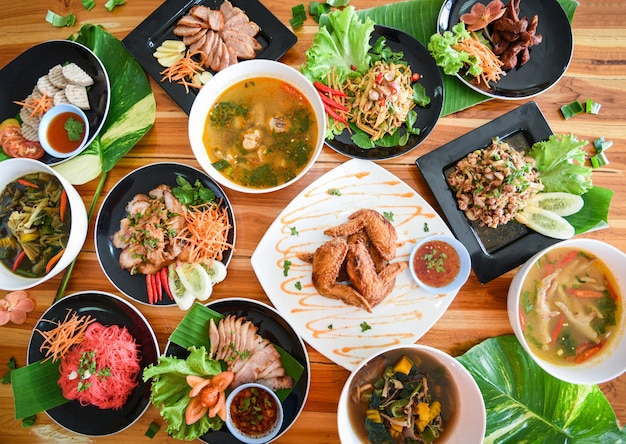 Thai food served on dining table  tradition northeast food isaan delicious on plate with fresh vegetables. Premium Photo