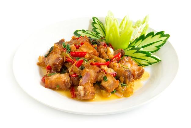 Thai food stir-fried crispy pork spicy and thai basil served  and cucumber Premium Photo