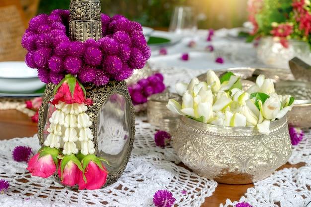 Thai food table decoration silver ware garland Premium Photo
