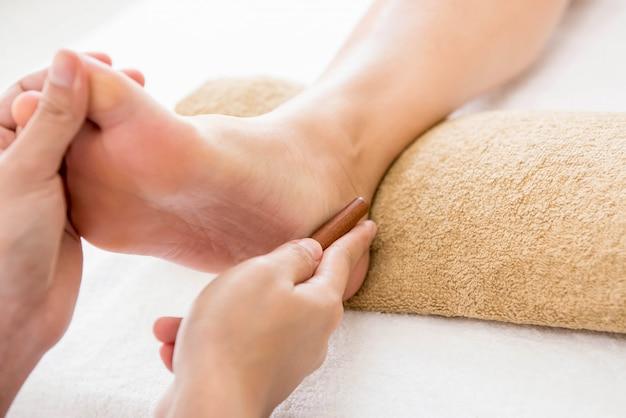 Thai foot massage with aroma therapy and reflexology Premium Photo