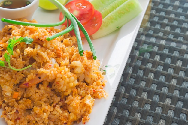 Thai fried rice with chili sauce ready to be eaten Free Photo