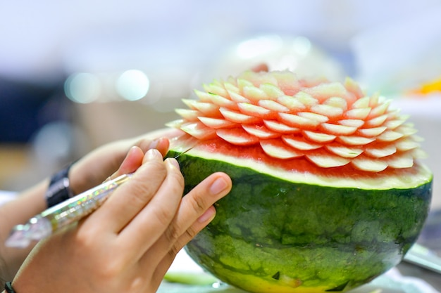 Thai fruit carving with hand vegetable and fruit carving photo