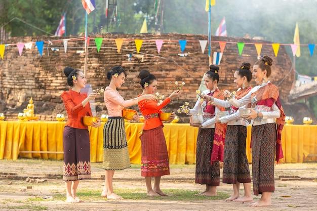 Thai girls and laos girls splashing water during festival songkran festival Premium Photo