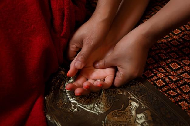 Thai hand massage. Premium Photo