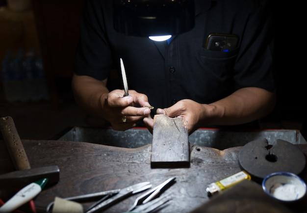 Thai jeweler making jewelry Premium Photo