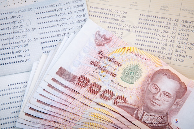 Thai money on two saving account passbook Premium Photo
