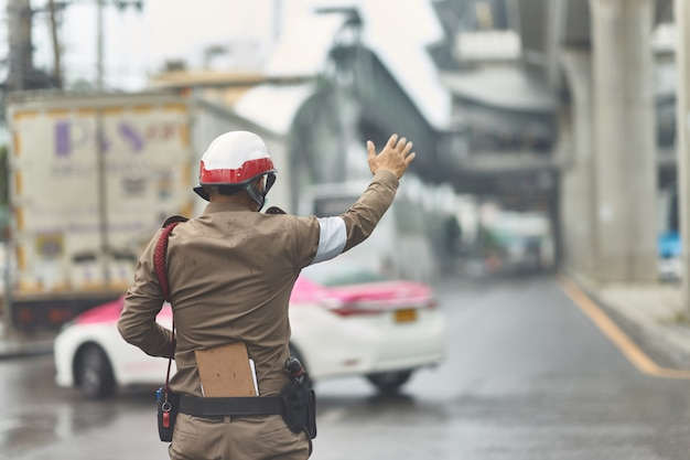 Thai traffic policeman in working action Premium Photo