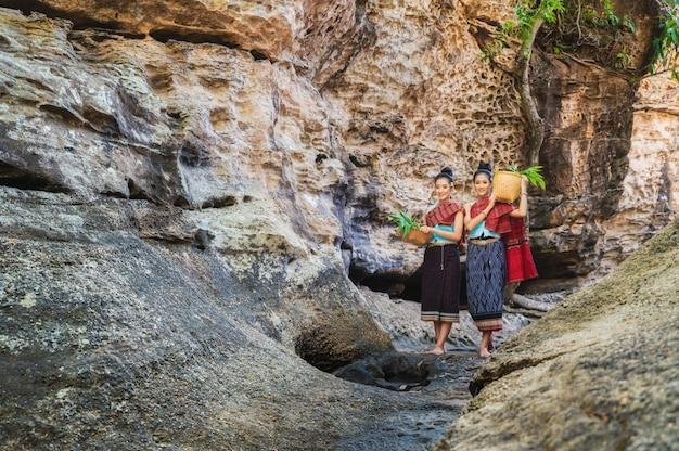 Thai woman in traditional costume of thailand. Premium Photo
