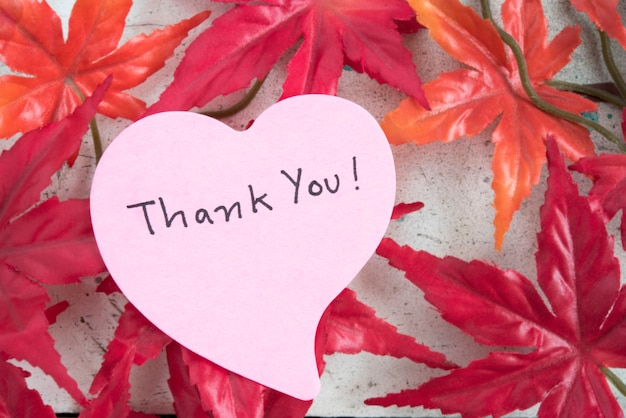 Thank you note in heart shape paper with maple leaf Free Photo