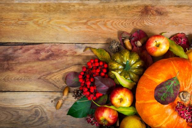 Thanksgiving background with orange pumpkin, green squash, . Premium Photo