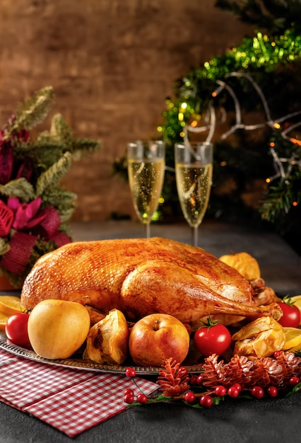 Thanksgiving roasted goose on rustic table Premium Photo