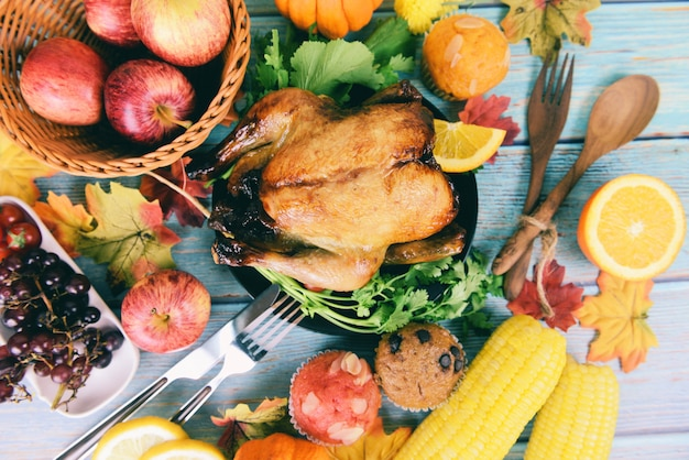 Thanksgiving table celebration traditional setting food or christmas table decorated many different kinds of food thanksgiving dinner with turkey vegetable fruit served on holiday Premium Photo