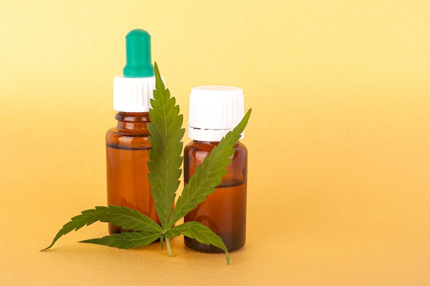 Thc and cbd extract medical cannabis oil, herbal elixir and natural remedy for stress and disease closeup. Premium Photo