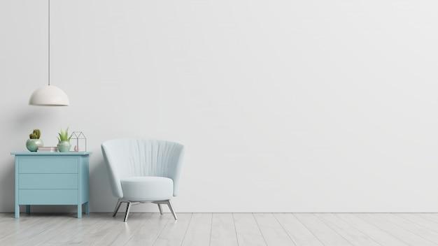 내부에는 빈 흰색 벽에 안락 의자가 있습니다. 무료 사진