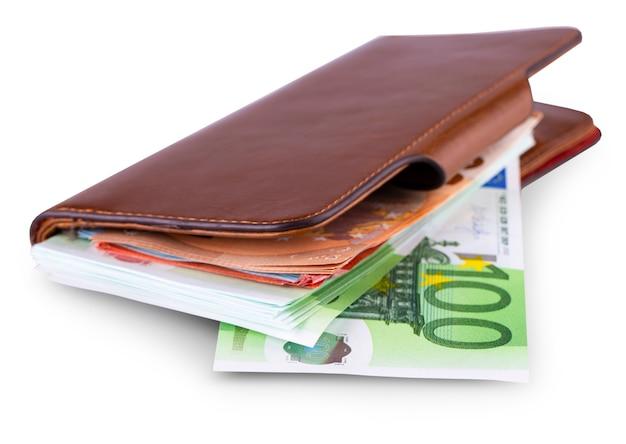 Кожаный кошелек и снятие европейской валюты Premium Фотографии