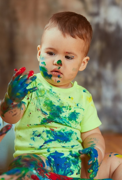 The Small Baby Painting His Hands Photo Free Download