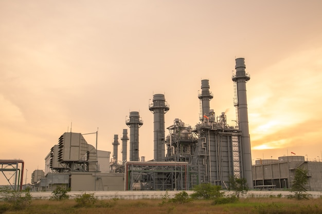 Thermal power plant for industrial estate on sunset. Premium Photo