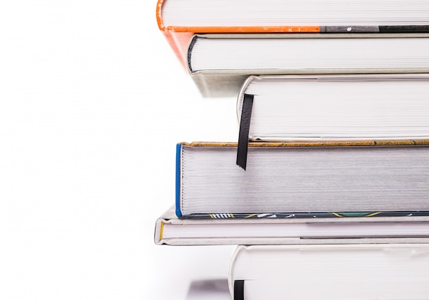 Thick books isolated on a white surface Free Photo