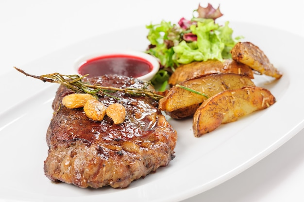Thick juicy beef steak with potato and salad Premium Photo